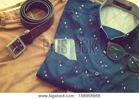 Men's Casual Outfits Background, Blue Shirt, Brown Short Pants, Brown Belt, Glass And Smart Phone
