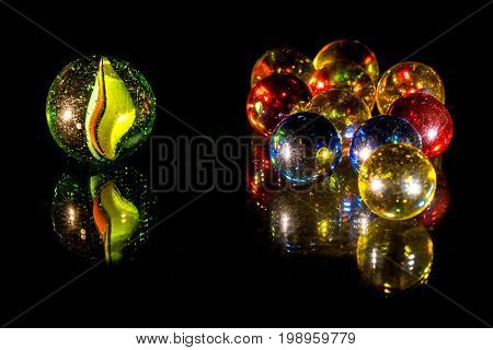 Mirrored colourful glass beads on black background