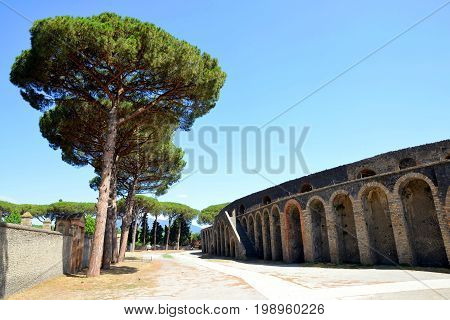Amphitheatre of ancient roman town of Pompeii, destroyed by vesuvius eruption - Campania, Italy