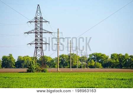 Supports for overhead power transmission lines on the field