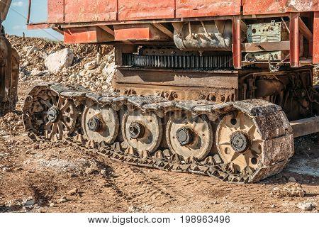 Caterpillars or tracks of large industrial excavator, quarry equipment concept