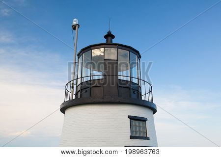 Small Castle Hill lighthouse in Newport Rhode Island overlooking the Atlantic Ocean built in 1830