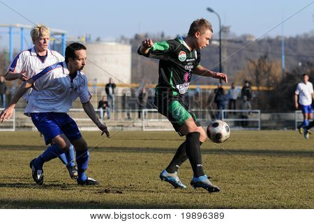 KAPOSVAR, HUNGARY - FEBRUARY 8: Unidentified players in action at a friendly soccer game Kaposvar vs. Veszprem - February 8, 2011 in Kaposvar, Hungary.