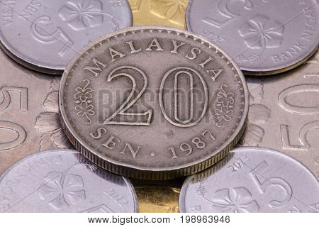 Detail of different Malaysian ringgit coins on the table.