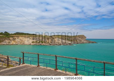 Promenade on the dramatic coast. Cape Mayor lighthouse in Santander Cantabria Spain