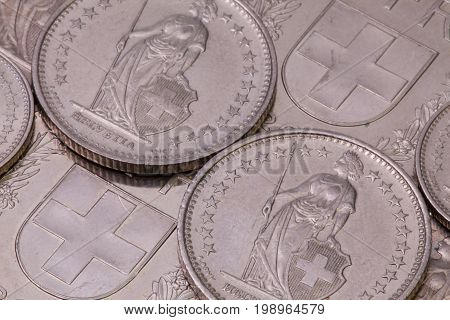 Detail of different swiss franc coins on the table.