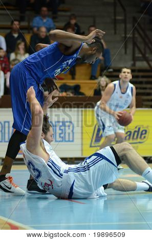 KAPOSVAR, HUNGARY - FEBRUARY 26: Unidentified players in action at a Hungarian National Championship basketball game Kaposvar vs Albacomp on February 26, 2011 in Kaposvar.