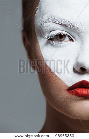 Cropped View Of Beautiful Teen Girl With Creative White Bodyart On Face, Isolated On Grey