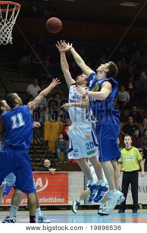KAPOSVAR, HUNGARY - FEBRUARY 26: Joshua Wilson (C) in action at a Hungarian National Championship basketball game Kaposvar vs Albacomp on February 26, 2011 in Kaposvar.