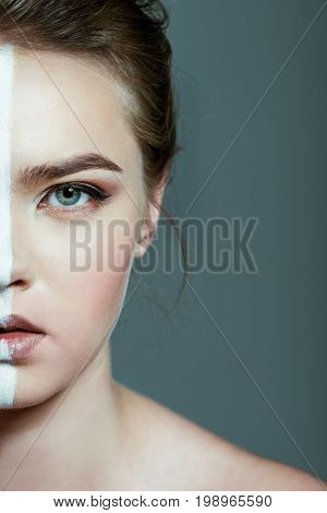 Halved View Of Beautiful Teen Girl With Creative White Body Art Line On Face, Isolated On Grey