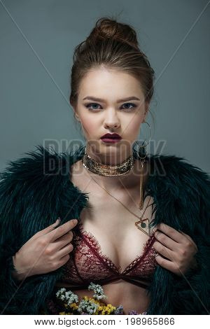 Young Seductive Attractive Model Posing In Lace Bra And Green Fur Coat For  Fashion Shoot, Isolated