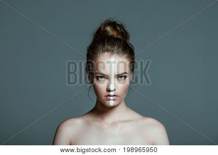 Young Beautiful Teen Girl With Creative White Body Art Line On Face Looking At Camera, Isolated On G