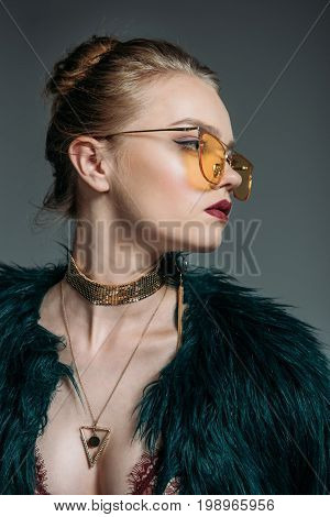 Young Beautiful Teen Model Posing In Green Fur Coat And Orange Sunglasses For Fashion Shoot, Isolate