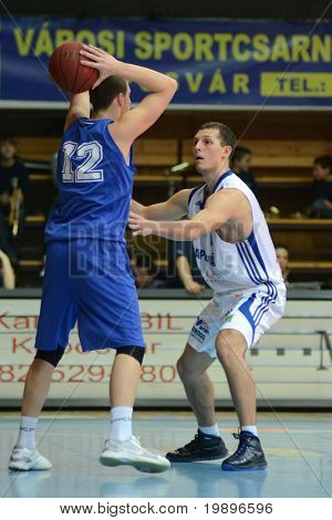 KAPOSVAR, HUNGARY - FEBRUARY 26: Mate Medve (R) in action at a Hungarian National Championship basketball game Kaposvar vs Albacomp on February 26, 2011 in Kaposvar, Hungary.