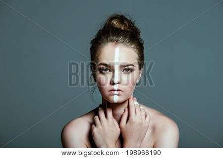 Young Beautiful Sensual Teen Girl With Creative White Body Art Line On Face, Isolated On Grey