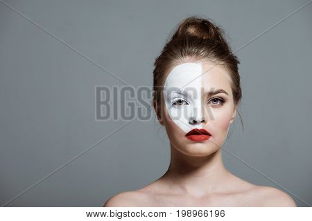 Young Beautiful Teen Girl With Creative White Bodyart On Face, Isolated On Grey