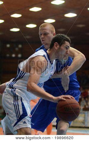 KAPOSVAR, HUNGARY - FEBRUARY 26: Unidentified players in action at a Hungarian National Championship basketball game Kaposvar vs Albacomp on February 26, 2011 in Kaposvar, Hungary.