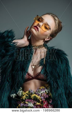Young Beautiful Seductive Girl Posing In Floral Skirt, Lace Bra And Green Fur Coat For  Fashion Shoo