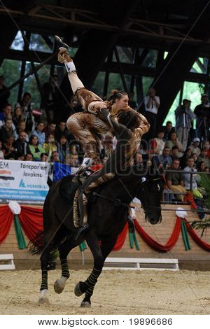 KAPOSVAR, HUNGARY - AUGUST 12: Slovakian competitors in action at the Vaulting World Championship Final on August 12, 2007 in Kaposvar, Hungary.