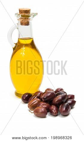 Olives with olive oil isolated on white background