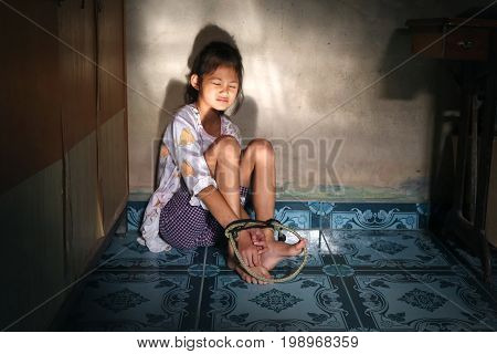 Asian human trafficking concept.Rope tied the hands of Thai girls.