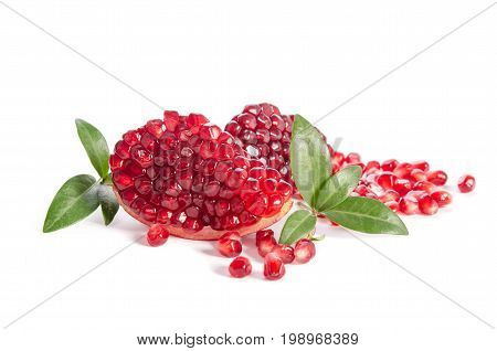 Part Of A Pomegranate With Pomegranate Seeds And Leaves Isolated On White Background