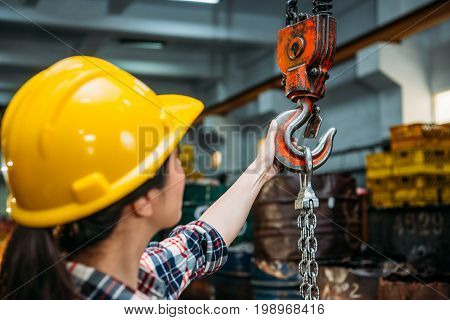 Industrial Factory Woman Holding Chain Crane