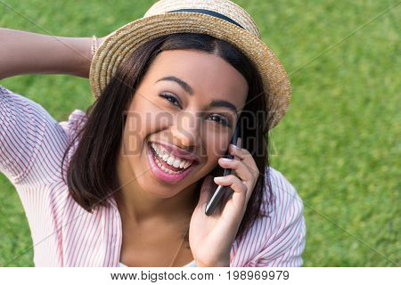 Close-up Portrait Of Beautiful African American Girl Talking On Smartphone And Smiling At Camera Out