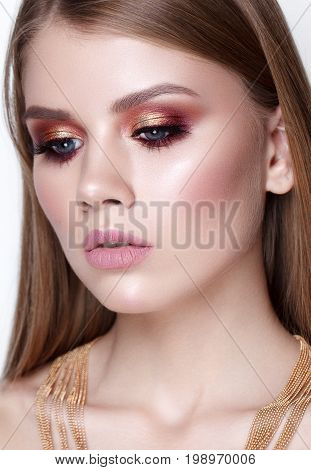 Close up portrait of beautiful young model with evening makeup, perfect skin, long hair. Trendy colorful smoky eyes.