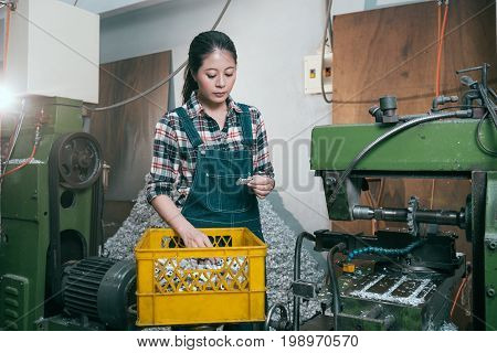Lathe Factory Female Manager Looking At Product