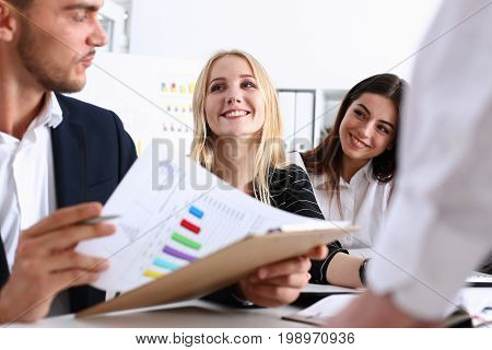 Group Of People Sit In Office Deliberate On Problem