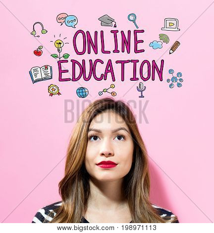 Online Education text with young woman on a pink background