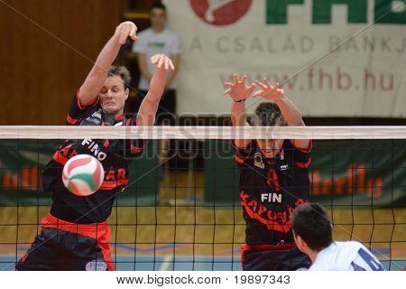 KAPOSVAR, HUNGARY - MARCH 6: Krisztian Csoma (L) blocks the ball at a Hungarian National Championship volleyball game Kaposvar vs. Kazincbarcika, March 6, 2011 in Kaposvar, Hungary.