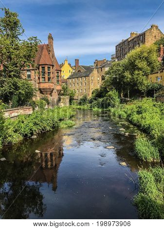 Historic and picturesque Dean Village in Edinburgh Scotland with Water of Leith flowing through it