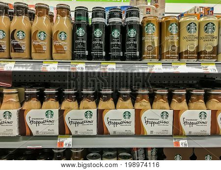 Basking Ridge NJ August 6 2017: Variety of Starbucks products on a shelf of a supermarket.