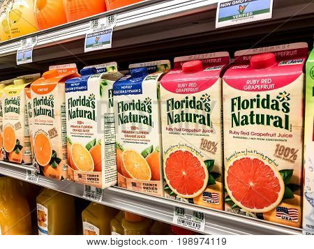Basking Ridge NJ August 6 2017: Cartons of Florida's Natural juice stand on a shelf of a supermarket.