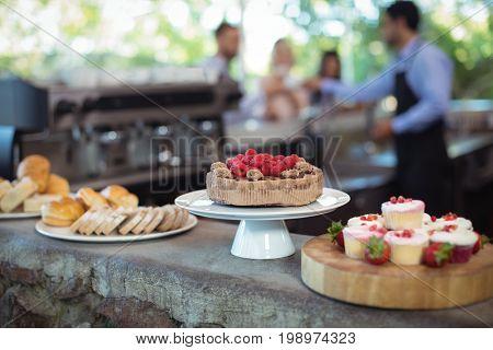 Desserts at counter in restaurant