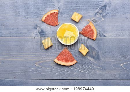 Composition Of Marble Cheese, Grapefruit And Honey