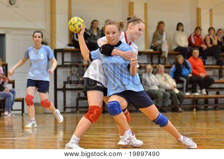 KAPOSVAR, HUNGARY - MARCH 13: Bernadett Sardi (with the ball) in action at Hungarian Handball National Championship III. match (Kaposvar vs. Kormend) March 13, 2011 in Kaposvar, Hungary.