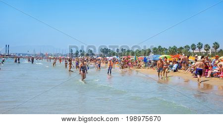 SALOU, SPAIN - AUGUST 3, 2017: Vacationers in the Llevant Beach in Salou, Spain. Salou is a major destination for sun and beach for European tourism, with more than 50,000 accommodations