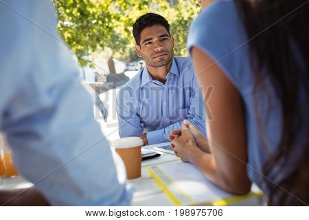 Friends interacting with each other in restaurant