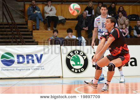 KAPOSVAR, HUNGARY - MARCH 18: Mark Deak (in black) receives the ball at a Hungarian National Championship volleyball game Kaposvar vs. Csepel, March 18, 2011 in Kaposvar, Hungary.