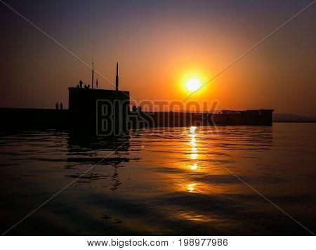 Submarine Novorossiysk on the background of sunset Russia