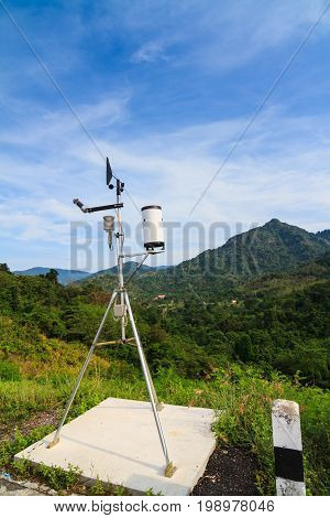 Weather Station Over The Dam With Mountain Background