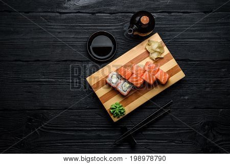 Japanese Cuisine. Salmon Sushi Roll (philadelphia) Over Dark Wooden Background