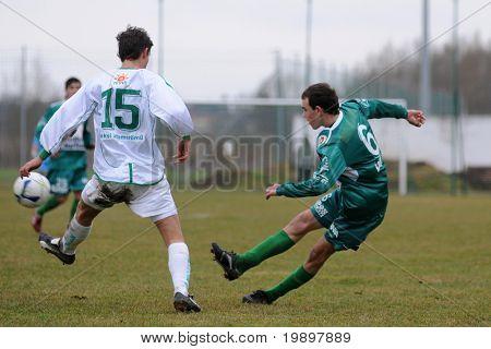 KAPOSVAR, HUNGARY - MARCH 19: Krisztian Kirchner (R) in action at the Hungarian National Championship under 19 game between Kaposvar and Paks on March 19, 2011 in Kaposvar, Hungary.