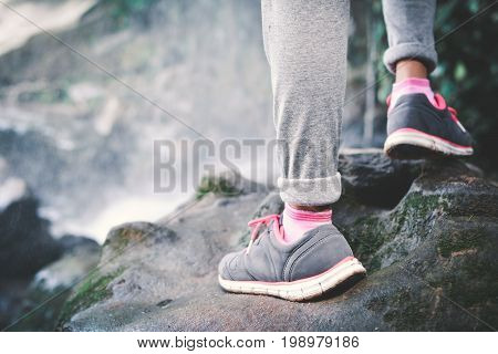 Feet of hipster girl walking in waterfall background Relax time on holiday