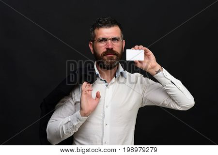 Man With Jacket And Beard Holds White Card