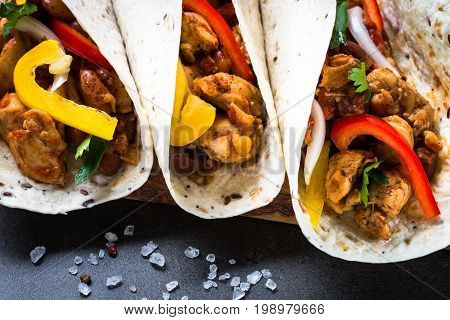 Mexican taco with meat beans and vegetables. Latin american food. Close up.