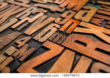 Many Antique letterpress wood type printing blocks
